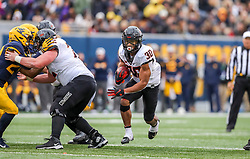 Nov 23, 2019; Morgantown, WV, USA; Oklahoma State Cowboys running back Chuba Hubbard (30) runs the ball during the fourth quarter against the West Virginia Mountaineers at Mountaineer Field at Milan Puskar Stadium. Mandatory Credit: Ben Queen-USA TODAY Sports
