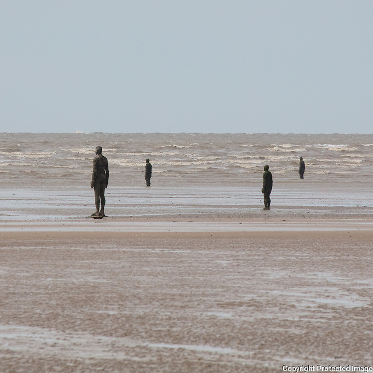 All the figures face towards the sea, Another Place, Crosby Beach, Merseyside.