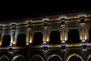 The old and ornate architecture viewed at night from the courtyard inside the Ulu Cami mosque in Diyarbakir, Turkey