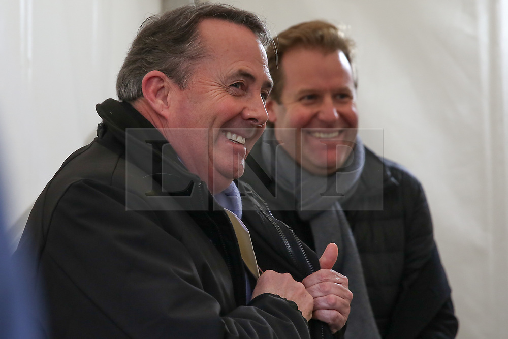 © Licensed to London News Pictures. 12/12/2018. London, UK. Liam Fox - Secretary of State for International Trade and President of the Board of Trade in College Green giving a radio interview. The British Prime Minister Theresa May announced that she will contest tonight's vote of no confidence in her leadership. Photo credit: Dinendra Haria/LNP