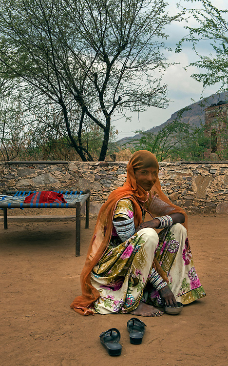 Portrait of tribal woman at home, near Pali, Rajasthan