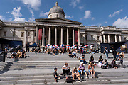 With many people and families staying in the UK for their Summer break during the school holidays, a large number of domestic tourists, who may normally have been travelling abroad, have decended on the capital to see the sights, as seen here in outside the National Gallery in Trafalgar Square on 10th August 2021 in London, United Kingdom. Following the Coronavirus / Covid-19 health scare of the last two years, and with some travel restrictions still in place, more people have chosen a staycation which is a holiday spent in ones home country rather than abroad, or one spent at home and involving day trips to local attractions.