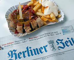 Detail of traditional Berlin curry wurst snack at famous Konnopke`s currywurst stall in Prenzlauer Berg in Berlin Germany