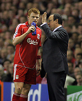Photo: Paul Thomas.<br /> Liverpool v PSV Eindhoven. UEFA Champions League. Quarter Final, 2nd Leg. 11/04/2007.<br /> <br /> John Arne Riise (L) of Liverpool and his manager Rafael Benitez.