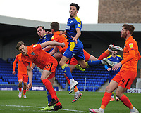 ,k m pFootball - 2020 /2021 Sky Bet League One - AFC Wimbledon vs Portsmouth - Plough Lane<br /> <br /> Ben Heneghan and Will Nightingale (5) of Wimbledon  jump above the Portsmouth defence<br /> <br /> Credit : COLORSPORT/ANDREW COWIE