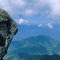 PERU. Peruvian guides survey view from Mount Shubet.
