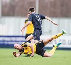 Livingston Simon Mensing pushed over by Falkirk's Conor McGrandles.<br /> Falkirk 1 v 1 Livingston, Scottish Championship game today at The Falkirk Stadium.<br /> © Michael Schofield.