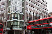 A London bus with an ad for dirty washing drives past the offices of Cambridge Analytica on New Oxford Street, the UK tech company accused of harvesting the personal details of Facebook users in its data privacy scandal, on 11th April, 2018, in London, England.