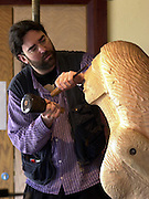 JEANIE JOHNSTON FIRGUREHEAD BEING CARVED...A life sized carving of Jeanie Johnston which will adorn the front of the famous replica Irish emigrant famine ship is slowly emerging at the shipyard in Blennerville outside Tralee. Dublin artist Andrew St. Ledger is currently working on the Larch wood carving in readiness for the ship's 10,000 mile maiden voyage to America in June which will be greeted by President Bill Clinton. .Picture by Don MacMonagle.Further details from Ann martin 066-7171681