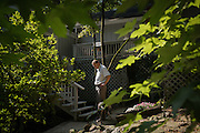 BIRMINGHAM, AL – JUNE 26, 2015: Louie Henry walks through the backyard of his Inverness home on the outskirts of Birmingham. In May of 2015 a background check conducted by Henry's employer revealed a prior conviction for falsely reporting a delinquent loan while Henry worked in the banking industry. Despite it being 14 years since the relatively minor incident, Henry lost his position as a sales-manager at the local medical-technology company after one day on the job. CREDIT: Bob Miller for The Wall Street Journal<br /> RESTRICT