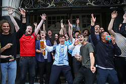 © Licensed to London News Pictures. 29/06/2021. London, UK. Fans celebrate outside The Salisbury Hotel in north London, after England win 2 - 0 against Germany in their Euro 2020 football match. Photo credit: Dinendra Haria/LNP