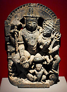 Vishnu and Lakshmi (Hindu religion), sculpted in stone from Rajasthan, India, circa 1495 AD.  Vishnu embraces lakshmi (goddess of wealth). Garuda the man-bird vehicle of Vishnu is set below.