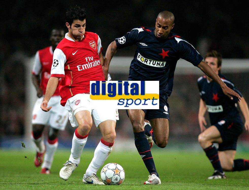 Photo: Tom Dulat.<br /> Arsenal v Slavia Prague. Group H, UEFA Champions League. 23/10/2007.<br /> Mickael Tavares of Slavia Prague and Cesc Fabregas of Arsenal with the ball.
