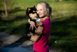 Child with a dog, on March 31, 2019 in Ljubljana, Slovenia. Photo by Vid Ponikvar / Sportida