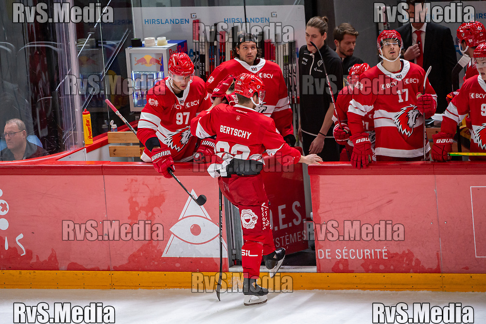 LAUSANNE, SWITZERLAND - SEPTEMBER 24: Christoph Bertschy #22 of Lausanne HC gets back to batch after a clash with Dominik Egli #46 of HC Davos during the Swiss National League game between Lausanne HC and HC Davos at Vaudoise Arena on September 24, 2021 in Lausanne, Switzerland. (Photo by Robert Hradil/RvS.Media)