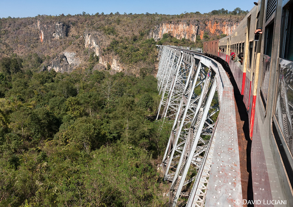 """The trip from Hsipaw to Mandalay by train takes about 13 hours. On the route you will pass over the highest bridge in Myanmar called Gokteik Viaduct. According to """"Wikipedia"""" - The Goteik viaduct (also known as Gohteik viaduct) is a railway trestle in Nawnghkio, western Shan State, Myanmar (also known as Burma). The bridge is between the two towns of Pyin U Lwin, the summer capital of the former British colonial administrators of Burma, and Lashio, the principal town of northern Shan State. It is the highest bridge in Myanmar and when it was completed, the largest railway trestle in the world. The bridge is located approximately 100 km northeast of Mandalay. The bridge was constructed in 1899 and completed in 1900 by Pennsylvania and Maryland Bridge Construction. The components were made by the Pennsylvania Steel Company, and the parts were shipped from the United States. The rail line was constructed as a way for the British Empire to expand their influence in the region. The construction project was overseen by Sir Arthur Rendel, engineer for the Burma Railroad Company."""