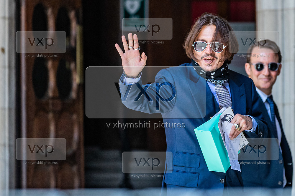 """American actor Johnny Depp arrives the High Court in London, Friday, July 17, 2020. Depp is in the trial against """"THE SUN,"""" a tabloid newspaper that accused him of abusing ex-wife Amber Heard. The Hollywood star is suing News Group Newspapers, publisher of The Sun, and the paper's executive editor, Dan Wootton, over an April 2018 article that called him a """"wife-beater."""" (VXP Photo/ Vudi Xhymshiti)"""