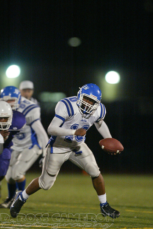 Encinal's John Brown runs with the ball during the first quarter of a high school football game agianst Castlemont, Friday, Sept. 15, 2006, in Oakland, Calif. (D. Ross Cameron/The Oakland Tribune)