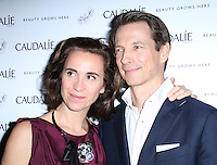 Matilde and Bertrand Thomas - Caudalie Founders arrive on the green carpet to celebrate the VIP opening of the UK's first ever French skincare brand Caudalie Boutique, Covent Garden, London UK, 10 February 2014, Photo by Richard Goldschmidt