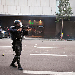 Police fight back with rubber bullets and tear gas.