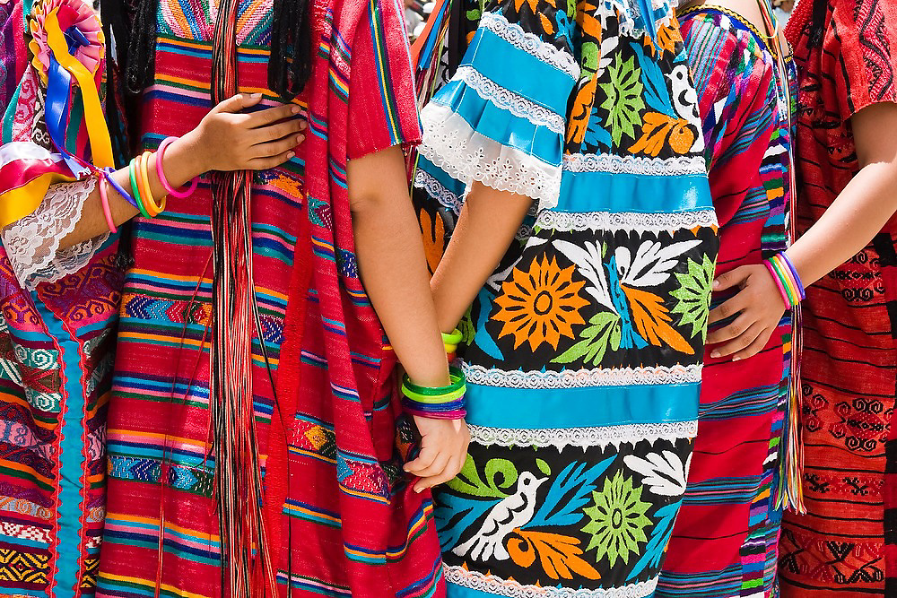 Women from the delegation of Tuxtepec stand together at the Guelaguetza Auditorium on Cerro del Fortin in Oaxaca City, Oaxaca state, Mexico on July 21, 2008. The Guelaguetza is an annual folk dance festival - dancers from all corners of the state gather in celebration in Oaxaca City and towns in the Central Valley to perform their traditional dances.