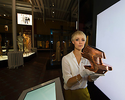 Pictured: Curator Georgina Ripley displays the Nova shoe by Zaha Hadid for United Nude<br /> <br /> The National Museum of Scotland will launch ten new galleries on 8 July following a £14.1 million redevelopment in their 150th year.  <br /> <br /> Ger Harley | EEm 5 July 2016