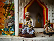 """22 MARCH 2018 - BANGKOK, THAILAND: A """"Spirit House"""" along Khlong Lat Phrao. Bangkok officials are evicting about 1,000 families who have set up homes along Khlong  Lat Phrao in Bangkok, the city says they are """"encroaching"""" on the khlong. Although some of the families have been living along the khlong (Thai for """"canal"""") for generations, they don't have title to the property, and the city considers them squatters. The city says the residents are being evicted so the city can build new embankments to control flooding. Most of the residents have agreed to leave, but negotiations over compensation are continuing for residents who can't afford to move.      PHOTO BY JACK KURTZ"""