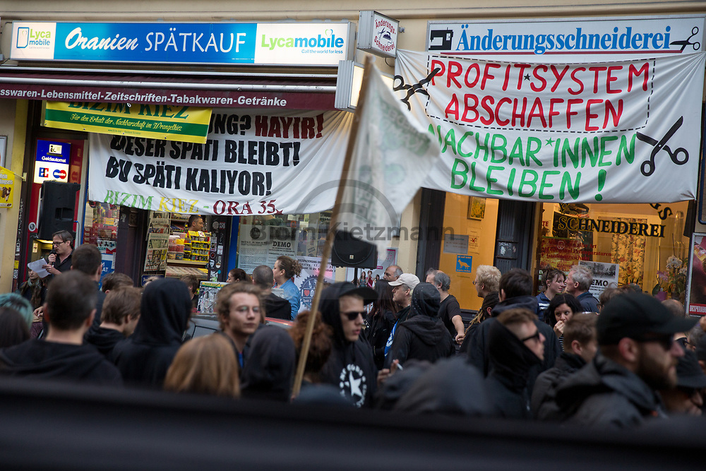 Berlin, Germany - 24.06.2017<br /> <br /> Demonstration pass the Oranienstrasse 35 - the local tailor's and kiosk are also threatened with forced eviction. Protest march against the announced police eviction of the left neighborhood center Friedel54 in Berlin-Neukoelln. <br /> <br /> Die Demonstration passiert in der Oranienstrasse 35 - die hier ansaessige Schneiderei und der Kiosk droht ebenfalls eine Zwangsraeumung. Demonstration gegen die angekuendigte Raeumung des linken Projektladens Friedel54. Raeumungstermin fuer das seit 13 Jahren bestehende Projekt aus Berlin-Neukoelln ist der 29.06.2017.<br /> <br /> Photo: Bjoern Kietzmann