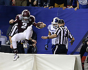 ATLANTA, GA - DECEMBER 31:  Quarterback Johnny Manziel #2 of the Texas A&M Aggies jumps over the field signage back onto the field after scoring a touchdown during the Chick-fil-A Bowl game against the Duke Blue Devils at the Georgia Dome on December 31, 2013 in Atlanta, Georgia.  (Photo by Mike Zarrilli/Getty Images)
