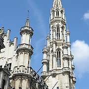 The main tower of the Town Hal in the Grand Place, Brussels. Originally the city's central market place, the Grand-Place is now a UNESCO World Heritage site. Ornate buildings line the square, including guildhalls, the Brussels Town Hall, and the Breadhouse, and seven cobbelstone streets feed into it.