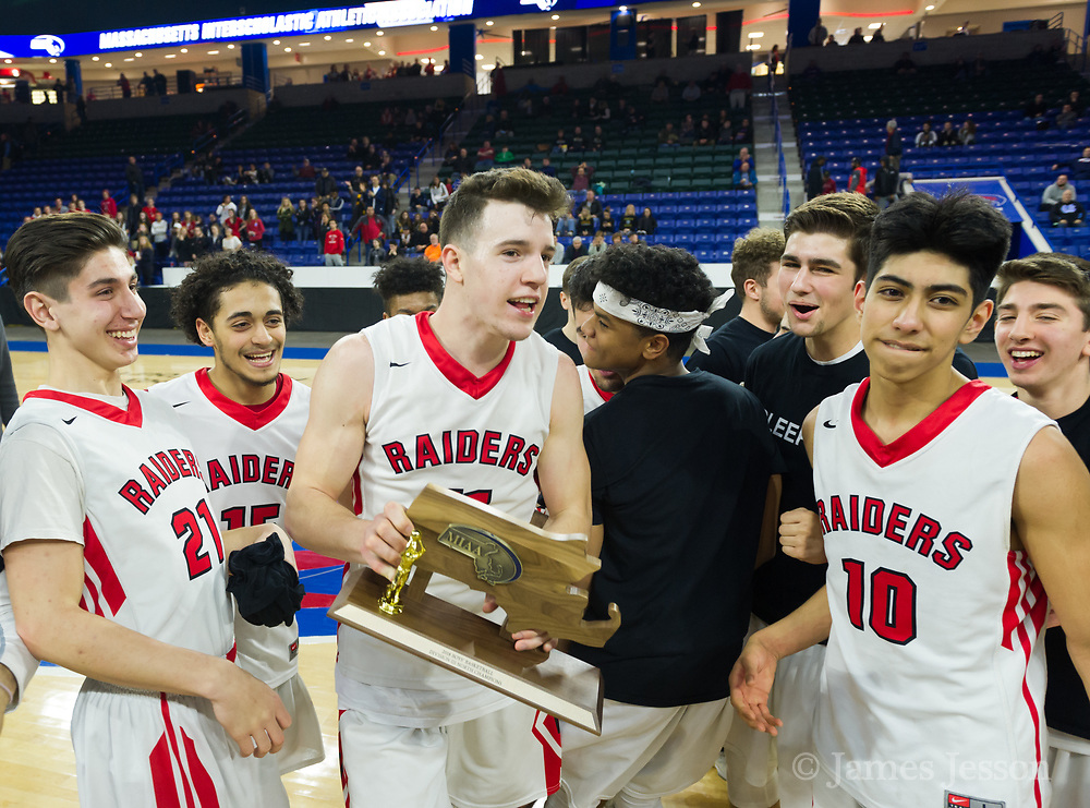 Watertown High School players celebrate with a trophy during the MIAA Division 3 North sectional final against St. Mary's at the Tsongas Center in Lowell, March 10, 2018. Watertown won the game, 44-36.   [Wicked Local Photo/James Jesson]
