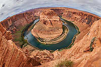 Horseshoe Bend, Arizona. Image taken with a Nikon D4 and 16 mm f/2.8 fisheye lens (ISO 100, 16 mm, f/11, 1/100 sec). Camera mounted on a monopod held out over the cliff.