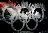 A snowboarder jumps through the Olympic rings at the opening ceremony for the 2010 Winter Olympics in Vancouver, Canada on February 12, 2010.  (UPI)