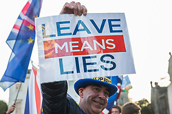 London, UK. 11th December, 2018. Anti-Brexit activist Steve Bray of SODEM (Stand of Defiance European Movement) protests outside Parliament on the day on which a vote was originally to have been scheduled on completion of a House of Commons debate on the Government's draft Brexit withdrawal agreement.