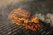 Beef steak grilled on a charcoal barbecue