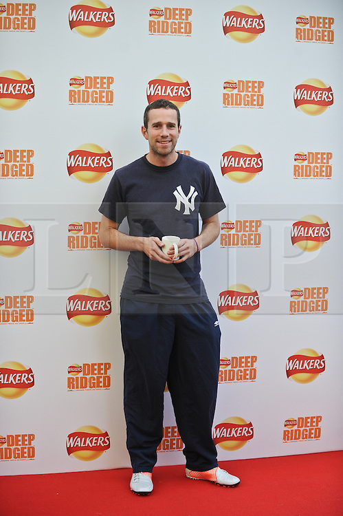 © Licensed to London News Pictures. 29/08/2012. London,UK.Max Rushden attending to the launch of new Walkers Deep Ridged crisps.To celebrate the launch Walkers will unveil 'Britain's Biggest Ever Crisp', a 22m high x 26m .Photo credit : Thomas Campean/LNP. .