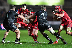 Scarlets' Wyn Jones is tackled by Ospreys' Bradley Davies - Mandatory by-line: Craig Thomas/Replay images - 26/12/2017 - RUGBY - Parc y Scarlets - Llanelli, Wales - Scarlets v Ospreys - Guinness Pro 14