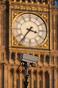A traffic CCTV camera mounted in front of the clockface containing the Big Ben bell in the Elizabeth Tower of the British parliament, on 17th January 2017, in London England.
