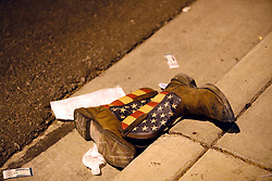 A pair of cowboy boots is shown in the street outside the concert venue after a mass shooting at a music festival on the Las Vegas Strip Sunday, Oct. 1, 2017. STEVE MARCUS