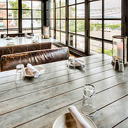 The interior of Virtue Feed & Grain, a restaurant and bar in a renovated historic building on Old Town Alexandria's waterfront.