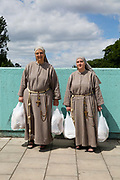 Two nuns with shopping bags, recently arrived in London to establish and teach the gospel, walking home after shopping on 7th June 2017 on Streatham Hill, South London, United Kingdom
