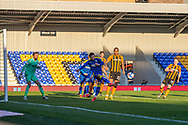 AFC Wimbledon defender Cheye Alexander (7) clears the ball during the EFL Sky Bet League 1 match between AFC Wimbledon and Hull City at Plough Lane, London, United Kingdom on 27 February 2021.
