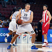 Anadolu Efes's Dusko SAVANOVIC (C) during their Two Nations Cup basketball match Anadolu Efes between Olympiacos at Abdi Ipekci Arena in Istanbul Turkey on Sunday 02 October 2011. Photo by TURKPIX