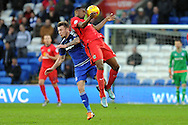 Blackburn Rover's Hope Akan (red) beats Cardiff City's Joe Ralls to a header. Skybet football league championship match, Cardiff city v Blackburn Rovers at the Cardiff city stadium in Cardiff, South Wales on Saturday 2nd Jan 2016.<br /> pic by Carl Robertson, Andrew Orchard sports photography.