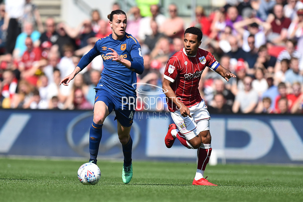 Jackson Irvine (4) of Hull City on the attack chased by Korey Smith (7) of Bristol City during the EFL Sky Bet Championship match between Bristol City and Hull City at Ashton Gate, Bristol, England on 21 April 2018. Picture by Graham Hunt.