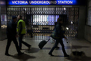 Commuters walk past closed station gates at Victoria during the 24hr tube strike affecting Londoners and passengers throughout the capital, on 9th January, at Victoria Station, London, England. The industrial action, coordinated by the Rail, Maritime and Transport (RMT) union and the Transport Salaried Staff's Association (TSSA), closed the vast majority of underground lines.