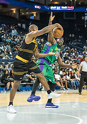 July 6, 2018 - Oakland, CA, U.S. - OAKLAND, CA - JULY 06:  Metta World Peace (15) co-captain of the Killer 3s grabs the ball from Reggie Evans (30) co-captain of 3 Headed Monsters during game 4 in week three of the BIG3 3-on-3 basketball league on Friday, July 6, 2018 at the Oracle Arena in Oakland, CA (Photo by Douglas Stringer/Icon Sportswire) (Credit Image: © Douglas Stringer/Icon SMI via ZUMA Press)