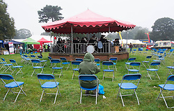 © Licensed to London News Pictures. <br /> 20/09/2014. <br /> <br /> Stokesley, England<br /> <br /> A lone man sits in the rain and listens to the brass band during the Stokesley Agricultural Show in North Yorkshire, England. The show which dates back to 1859 is the largest one day agricultural show in the north of England.<br /> <br /> Photo credit : Ian Forsyth/LNP