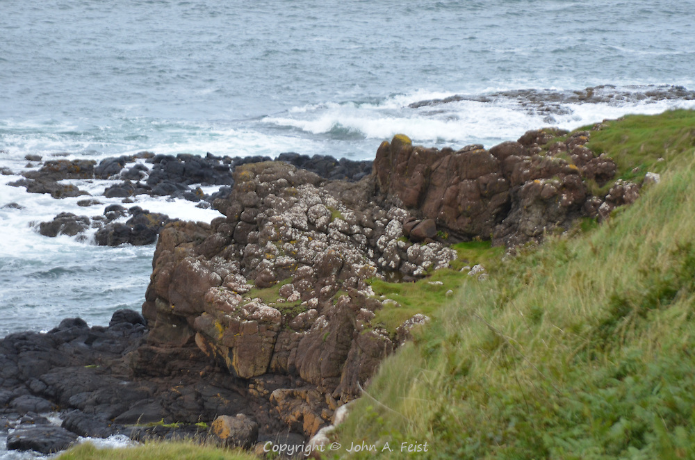 The start of the Giant's Causeway heading into the sea.  County Antrim, Northern Ireland.