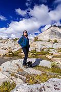 Hiker enjoying the view in Dusy Basin, Kings Canyon National Park, California USA